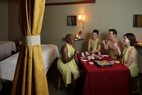 Enjoying sushi their massage session