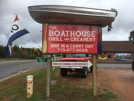 Conover, WI: Sign with a boat on top!