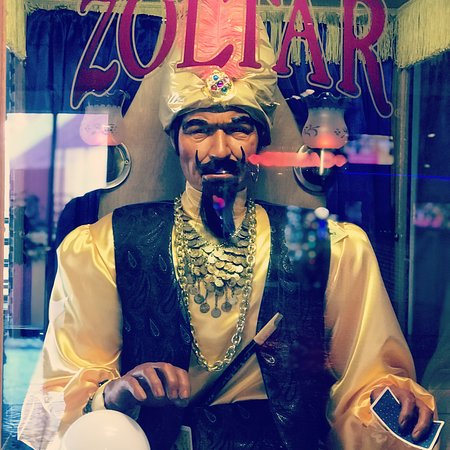 Zoltar greets you as you leave the parking lot and head towards check in!