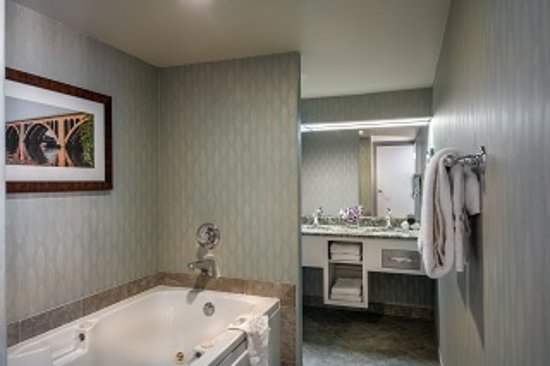 This Penthouse Has A Large Bathroom With Jacuzzi Tub Picture Of