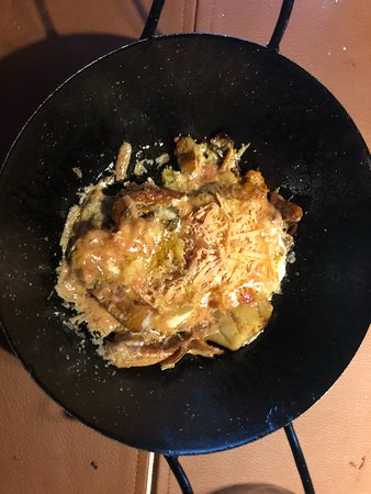 Ger, Spain: Plato de temporada: huevos trufados con variedad de setas y foie