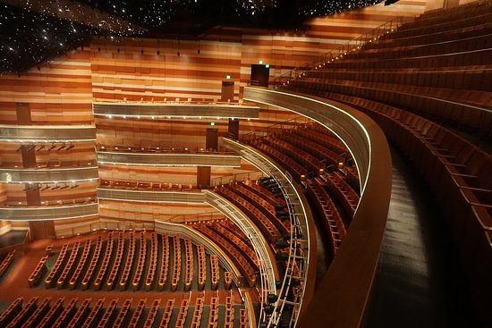 The Eccles Theater has three tiers of seating above ...