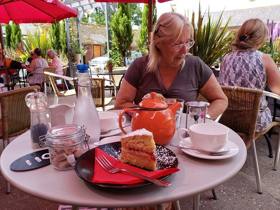 Lytchett Matravers, UK: A Victoria Sponge and Tea in the courtyard of The Barn Cafe