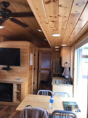 Garden of the Gods RV Resort: Escape cabin dining/kitchen area facing bedroom.