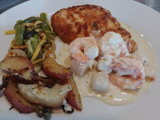 Camden, MO: Fresh Halibut with a King Crab, Scallop & Shrimp Sauce; accompanied by seasonal vegetables!
