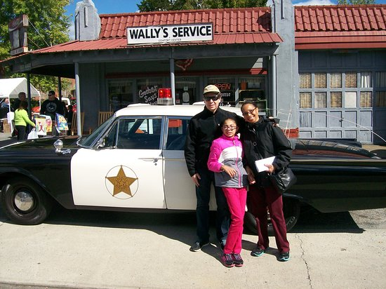 Striking a Pose after riding the Replica Squad Car Tour, in Mayberry (Mt. Airy, NC