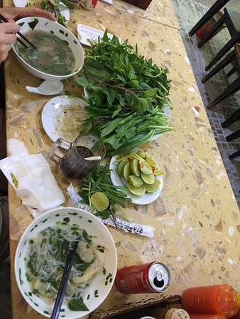 Pho with fresh limes, chilli, herbs
