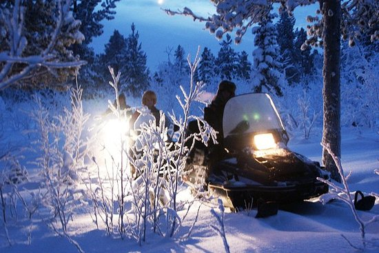 Snowmobile Aurora Expedition con cena