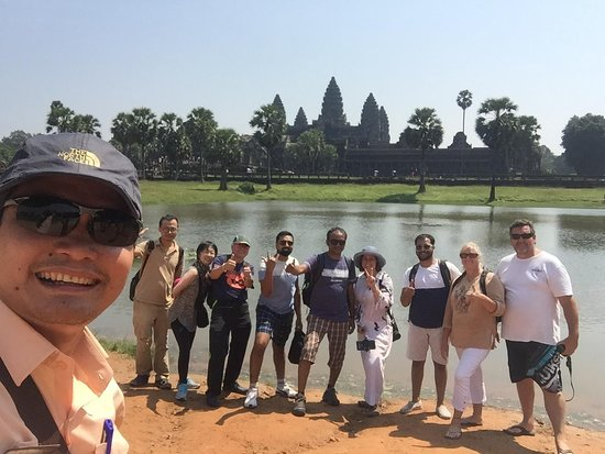Chhayakim Private Angkor Wat Tours: Photo taken with our awesome tour guide, Mr. Kim near the east entrance of Angkor Wat temple