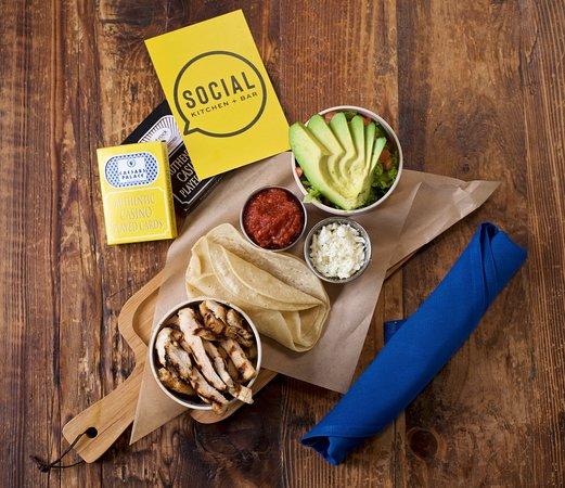 Social Kitchen + Bar: Deconstructed Taco Board (Ranchero chicken, avocado, salsa, cotija cheese and warm corn tortilla