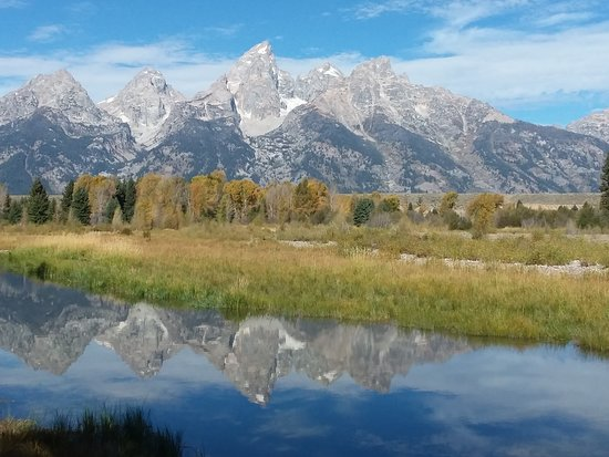 Reflection of the mountains in the snake river