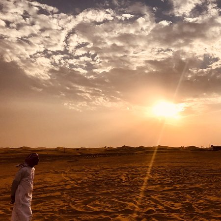 Evening Desert Safari With BBQ Dinner, Henna Painting, Camel Ride and Belly Dance Photo