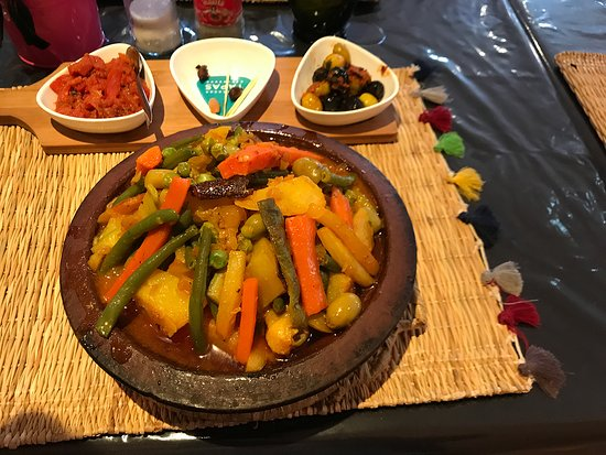 Tajines dish with fresh vegetables and chicken