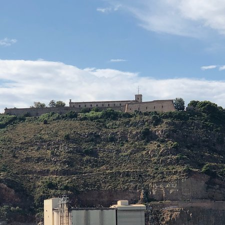 View from Barcelona port and up close from some of Montjuic's historic artillery.
