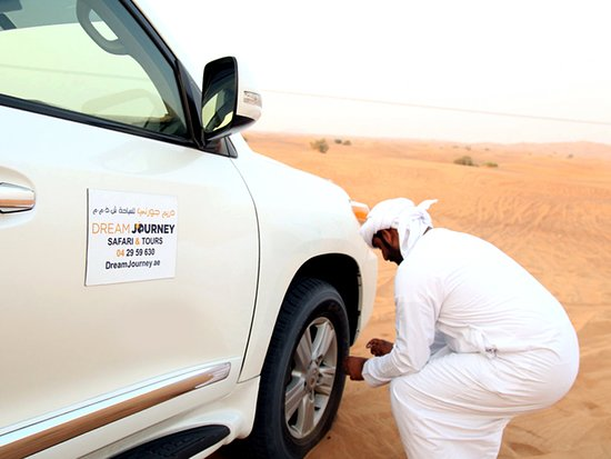 Dream Journey: Inflating tyres before heading inside the desert. This provide better traction in sand dunes.