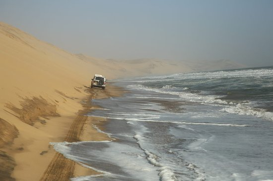 Sandwich Harbour- Guided Self-Drive Tour from Walvis Bay: Driving through the water to get to Sandwich