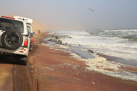 Sandwich Harbour- Guided Self-Drive Tour from Walvis Bay: Red sand and mudbanks