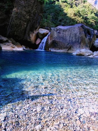 This is a natural river swimming pool in Nongriat, Meghalaya