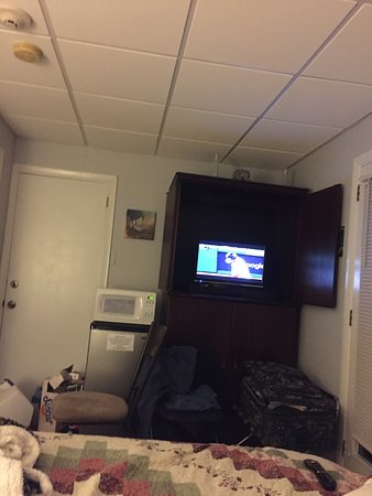 Winnisquam, NH: TV from bed. Couch is next to bed on left.