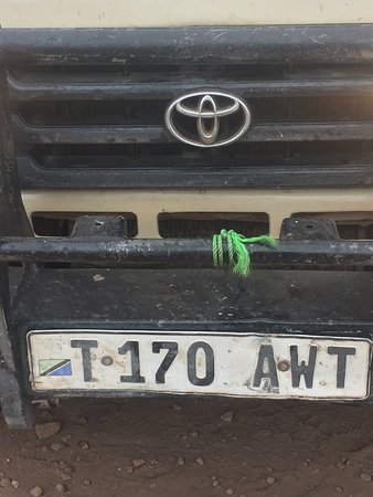 car-hood only held down by being stripped down by a piece of string