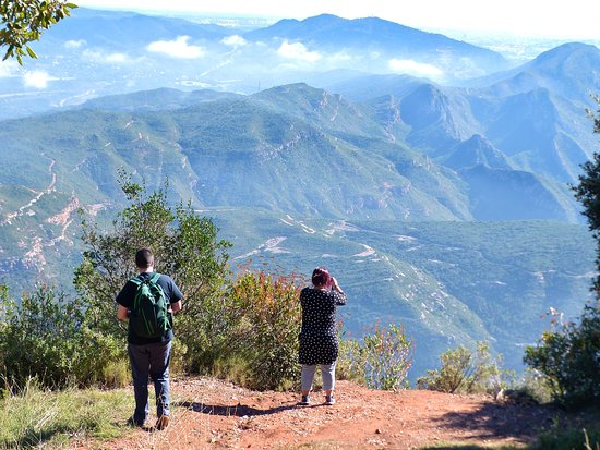 Montserrat hike, wine tasting, and tapas from Barcelona: Us taking in the view. Photo credit: Pere Sauret