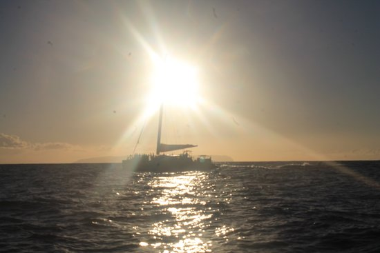 Kauai Sunset Catamaran Cruise with Cocktails: Setting sun on the coast of Kauai