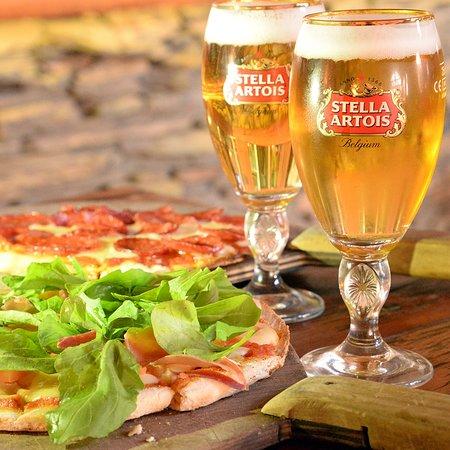Lo Barnechea, Chile: Nuestras pizzas acompañada de un rico Shop Stella Artois