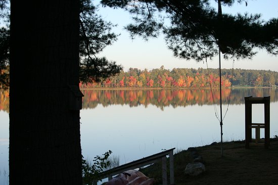 Poland, ME: view over the lake from the easy chairs in the morning