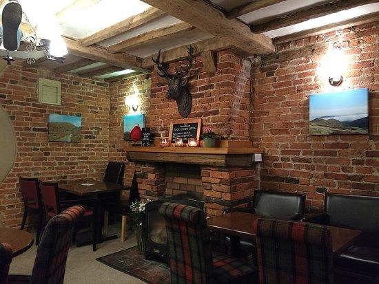 Little Stretton, UK: Fireplace in bar area