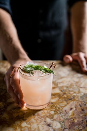 Dill-iscious Cocktail: dill-infused gin with elderflower liqueur, rhubarb syrup, and citrus esse