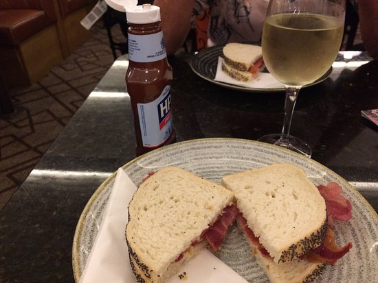 J D Wetherspoons Birmingham Airport: Perfect Bacon sarnie, HP sauce and nice wine - at 5.30? Excellent :)
