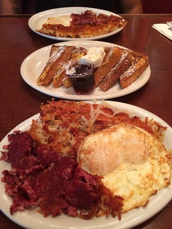 Russell's: Very crisp huge portion of hash - and look at the French toast in the back :-)