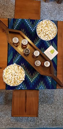 A flight of beers and some popcorn to share among friends!