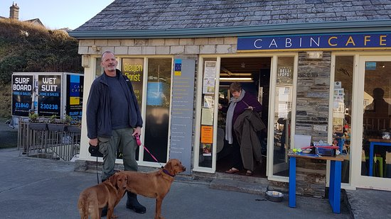 Me and my dogs outside the Cabin Cafe at Crackington Haven.