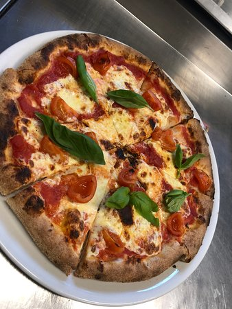 Customer photo of margherita pizza