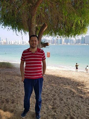 Emirate of Abu Dhabi, United Arab Emirates: Abu Dhabi Heritage Village, myself and kids playing in the shore.