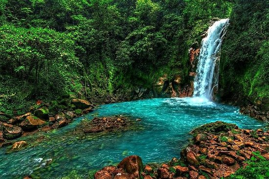 Celeste river waterfall and volcano...