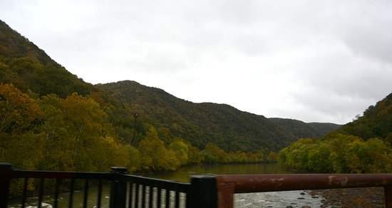 Thurmond, WV: View looking up the New River from the Bridge into town.
