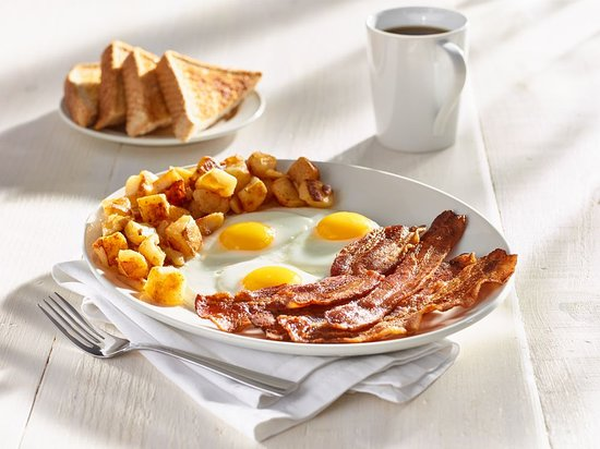 Sunset Grill : Five strips of premium bacon, three eggs, and home fries served with thick toast.
