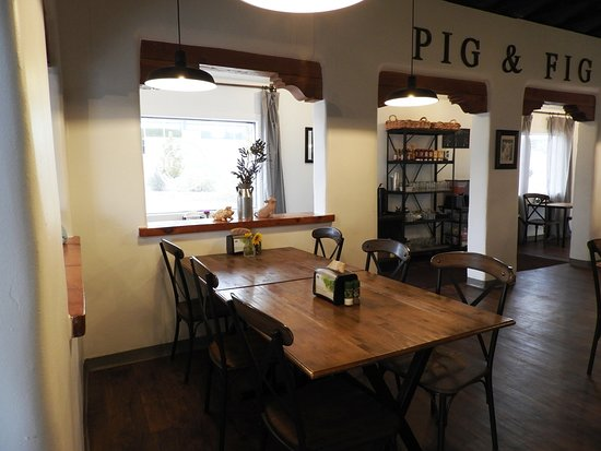 Pig+Fig Bakery and Cafe: Interior is very crisp and refreshing - except the front door does bang as people come and go!!