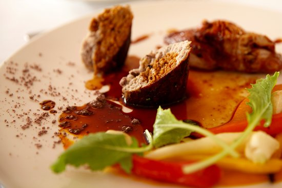Slow cooked Baldivis rabbit stuffed with Kalamata olives, carrot purée, heirloom carrots, baby turnip, rosemary jus, olive crumbs