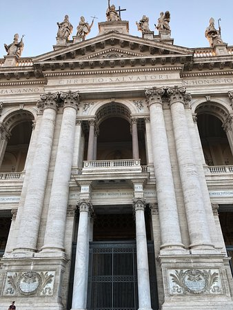 The main entrance, with papal and other statues above the baroque facade