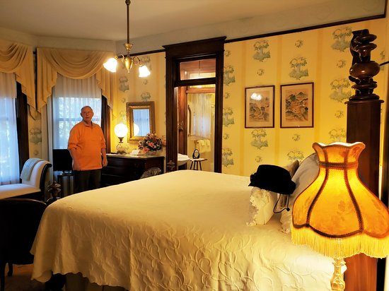 """View into the Wright Suite with its own private bath, fireplace, and breakfast room. The bed had a two-step stool to access the bed which is higher than usual from the ground. Felt like I was in the """"Princess and the Pea"""" bed!"""