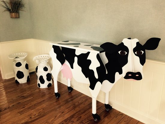 Manchester, VT: Chip made these great milkcan cow seats for us.
