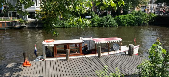 private canal boat Delphine in Summer at the Rijksmuseum dock