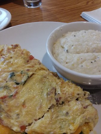 Spinach Bacon Cheddar Omelet and grits
