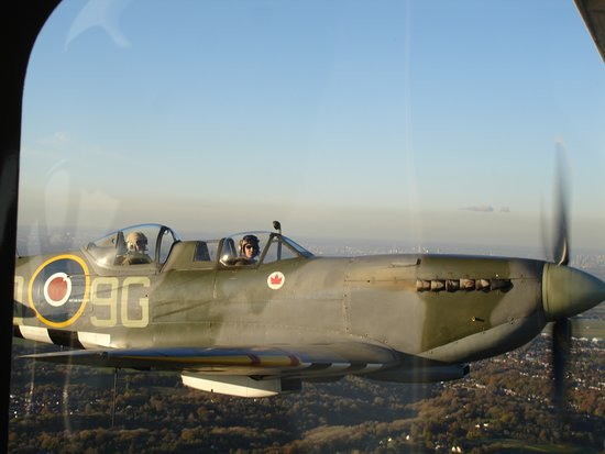 Biggin Hill, UK: Alongside... a perfect photo op for a Spitfire in flight