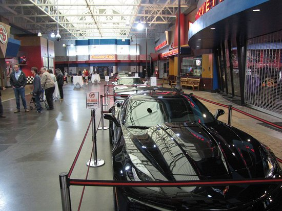 Looking down line of Corvettes in entrance hall