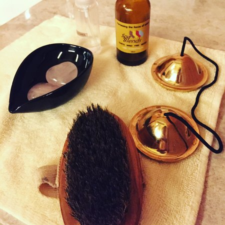Relaxation tools like massage crystals, pore brush as part of pre treatment rituals at The Retreat Spa in Okada