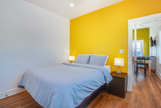 Prime Guestroom With Yellow Accent Wall Picture Of Venice Suites Home Interior And Landscaping Ferensignezvosmurscom